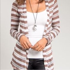 Brown & White Cardigan NWT! Beautiful white and brown cardigan with diagonal stripes, wide collar that can be folder over, long tunic length, 2 loops for a thin belt, lace-like sheer at some places, and long sleeves. There is a small snag on left side under the sleeve but your arm will hide it. Reduced rating & price. ⭐️⭐️⭐️⭐ It is the BUYER'S responsibility to ensure an item will fit.  ✅ASK QUESTIONS ✅Bundle ✅Offers ❌NO Trades ❌NO Off-Site Transactions Almost Famous Sweaters Cardigans