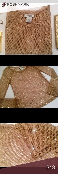 Charolette Russe Night Paris Gold Sequin Top The Night Paris top is a dazzling gold sequin on a long sleeve netting made of polyester. It's your time to shine! Charolette Russe Tops Blouses