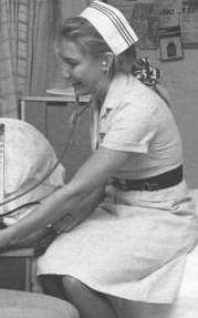 3rd year student nurse - indicated by the number of stripes on her cap - 1990's