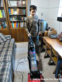 Putting Boys to work with the Eureka SuctionSeal 2.0 vacuum #EurekaPower #CollectiveBias #ad