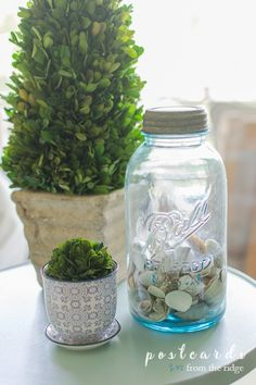 So many creative and beautiful ways to decorate with vintage bottles and mason jars. #vintagedecor #homedecor #masonjars