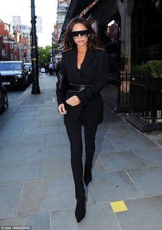 Off she goes: Victoria Beckham continued to put the split rumours behind her as she steppe...