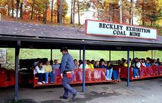 This miner is about to take a tour group through the Beckley Exhibition Coal Mine.  Note how warmly everyone is dressed...if you go, bring a jacket, even if it is hot outside, because it won't be in the mine!  (via Flickr)