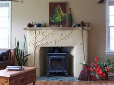 Resurface a fireplace with stucco pinterest house fire places earthen plaster over brick living room fireplace remodel by artisan builders collective via flickr solutioingenieria Image collections