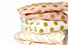 These beautiful modern crib sheets will add a little glam to your nursery. Golden metallic dots on a Pink background shimmer beautifully, dont