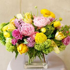 """Nothing says """"Spring"""" like these dreamy pink and sunshine yellow blooms! Looking for a holiday centerpiece or the perfect host/hostess gift? Order now and we'll deliver Friday! Enjoy it all weekend long! Ranunculus, Peonies, Tulips, Holiday Centerpieces, Table Decorations, Enjoy It, Flower Delivery, Hostess Gifts, Floral Arrangements"""