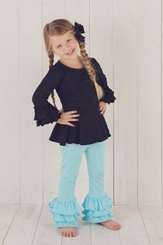 """Our 3-2-1 Triple Ruffle Pants are perfect for the growing little girl!  This update to a classic boutique style allows you to remove a ruffle as your child grows, allowing too-short pants to become capris and too-short capris to become shorts.  Model is approximately 43"""" tall and is wearing a Size 6. These are the perfect match to clothing lines like  Matilda Jane  Persnickety Eleanor Rose Kellys Kids  Well Dressed Wolf  with free shipping!"""