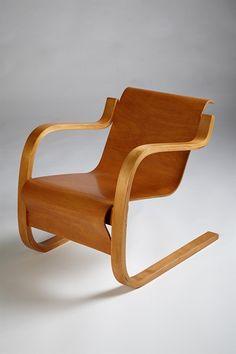Armchair, designed by Alvar Aalto for Artek, Finland. 1940's.  Birch and birch plywood.