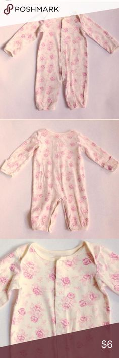 Roses sleep & play Off white one piece sleep and play with a beautiful delicate rose pattern. Soft cotton. Full length snaps for easy diapering. Wrap over hand mitts for safety. Lovely little outfit! Size 6-9 months. Dresses