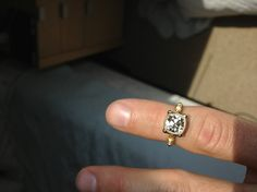Facing up pretty white given the overcast skies and the color of the stone! (and a little shout-out to the fantastic staff at Chalmers Jewelers)  READ MORE FROM THIS BLOG:  http://www.pricescope.com/forum/show-me-the-ring/i-can-t-believe-this-used-to-be-an-o-avc-t190579-30.html