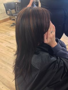 Brown hair with Carmel highlights by Hannah Lette at ladies and gentlemen hair salon