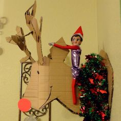 Elf on cardboard reindeer