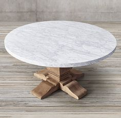 "RH's Salvaged Wood & Marble Trestle Round Dining Table:Our table pairs a 2""-thick marble top with the natural beauty of solid salvaged…"