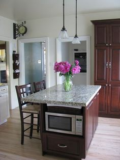 small kitchen island ideas.....not sure I could handle my microwave that low. But everything else looks nice