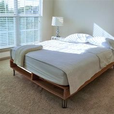 """8"""" tall, three-rod, 1/2"""" diameter hairpin legs by Define Modern on the base of my DIY cedar pallet bed frame. A good way to use hairpin legs in a way that isn't MCM."""