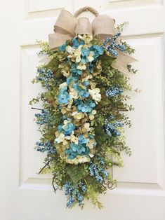 Hydrangea Wreath Swag-Seaside Sand~ Timeless Floral Boutique~A melody of blues for a welcoming front door.