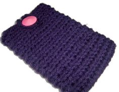 Dark purple crochet cell phone cozy with a pink button, made out of worstead weight yarn.  This case looks cute and will help protect your cell phone from getting any scratches.