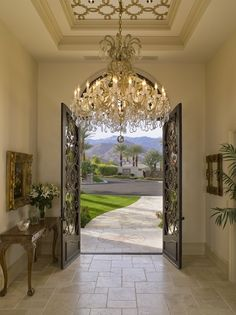 old world luxe design....wow look at those doors, chandelier, molding