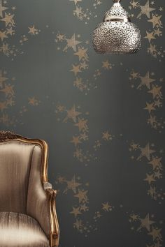 Looking for a wallpaper with a cascade of golden stars printed on dark grey for maximum impact?  This wallpaper from Barneby Gates would look stunning in small dark rooms