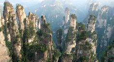 With its towering sandstone pillars, dizzying stone bridges and mysterious caves, the Wulingyuan Scenic Area is one of China's most aesthetic natural sights. Description from ecotraveller.tv. I searched for this on bing.com/images