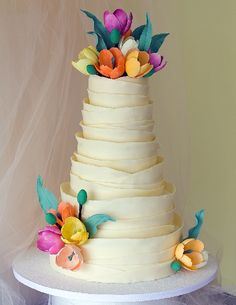 Tulips wedding cake, its not about how tall it is or how much bigger than anyone elses. its about the pureness of the design and how it just wants to make you reach out and touch it .. then cram it into your mouth.. yummm ... so cute