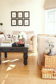 love the coffee table, wicker baskets, numbered pillow