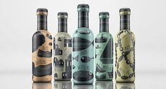Five Ouzo Mitilini bottle packaging designs, each featuring a different illustration that embodies Greece.