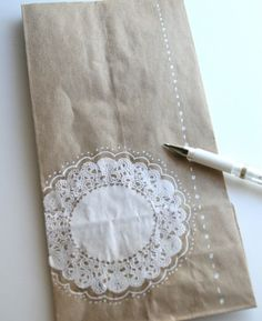 How amazing would this doily paper bag look if you asked your calligrapher to add your guests names in the center of the doily in a fancy script? Pretty amazing, I think. This is certainly a paper bag your guests will not  want to throw away.