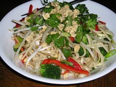 La Bou Asian Noodle salad 6-8 oz. noodles,¼ – ⅓ c peanuts,¼ – ⅓ cup bean spouts ,¼ – ⅓ cup broccoli florets, blanched ,½ red bell pepper 2-3 green onions,¼ cup cilantro Dressing:2 tbsp.soy sauce 2 tbsp. rice vinegar,2 tbsp. toasted sesame oil 1 tbsp. brown sugar,1 tsp. Ginger,1-2 cloves garlic, crushed,⅛ – ¼ tsp. hot chili oil