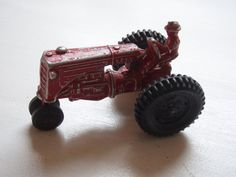old red metal farm tractor toy by ToadshadeLane on Etsy, $12.00
