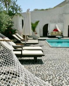 Mansion Sophia  ( Santorini, Greece )  Spend a lazy afternoon rocking on a hammock in your quiet pebbled courtyard. #Jetsetter #JSVolcano  #JSHammock