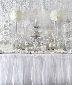 All white bridal shower sweets table | http://mytrueblu.com/all-white-bridal-shower-ideas/