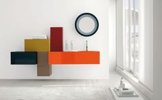 PATCHWORK .... E' il risultato di una composizione dove si gioca con profondità e colori in senso orizzontale e verticale. Dall'arancio al giallo ocra, il bagno è di tuo gradimento?