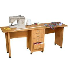 "American Furnishings Double Mobile Desk & Craft Center, 71"" W x 18"" x 29½"" H, Oak by American Furnishings. $229.95. The Double Mobile Desk & Craft Center from American Furnishings is the ideal working space for large or multiple projects. With dual work areas and room for two chairs, this double mobile desk offers a spacious 8 foot surface suited for writing, paying bills, crafts and much more. Constructed from durable stain resistant laminated wood composites, our large d..."