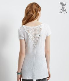 """For style success, you don't need the sun, moon and stars to align -- flaunting this Junie and Jade Crochet Back Tunic will do the trick just fine! The chic piece is designed in a versatile shade with intricate boho crocheting on the back.<br><br>Relaxed fit. Approx. length: 26"""" (front); 29"""" (back).<br>Style: 2240. Imported.<br><br>Body: 80% rayon, 20% cotton.<br>Crochet: 100% cotton.<br>Machine wash/dry.<br><br>Model height: 5'10""""; Size: Small. $9"""