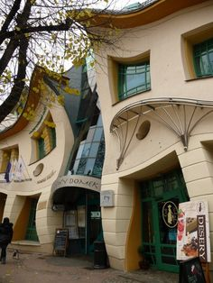 Krzywy Domek, a shopping center in Sopot, Poland is unique in its design. Designed by Szotynscy and Zaleski, its peculiarity is it has no right angle walls. All the wall is designed by curves. The creators were inspired by fairy tales of Jan Marcin Szancer and Per Dahlberg to create this unique structure. Amazing Architecture, Building, Construction, Buildings, Civil Engineering