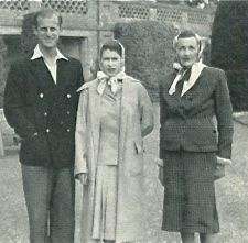 Less formal. Her Majesty the Queen and Prince Philip with my grand mother.
