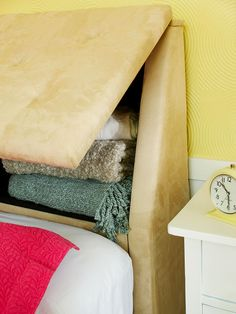 Need more storage in the bedroom? Why not use the headboard? Such a neat idea!