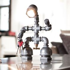 Tischlampe Kozo Man - how cute, stylish and handy is that lamp made out of old industrial pipes? If it weren't so f****** expensive, I'd order it right now...