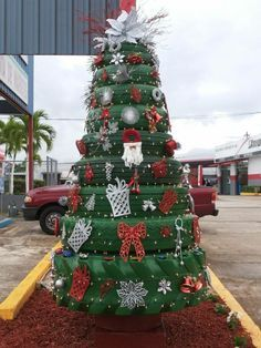 A Christmas tree is typically well – a tree. But who says it has to. Here is an outside tree made from salvaged tires. Spray painted green and decorated from largest to smallest from bottom u…