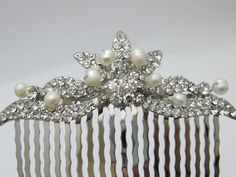 This vintage inspired stunning fresh water pearl rhinestone hair comb is beautiful addition to your wedding day hair style on the side or in back