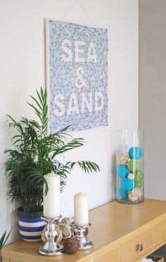 DIY wall decor for your home using some canvas, string and nails. A cool idea to brighten up a bare wall with some texture and color.