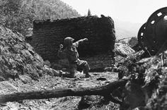 A US 25th Div. Inf. gets set to heave a grenade at enemy sniper hidden in a village 20 miles north Taegu on Naktong River front in Korea on August 29, 1950. (AP Photo)