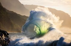 """""""Pop the Top."""" Waves shoot high into the evening air like champagne at a party in a celebration of life and the joy of being in nature. Na Pali Coast, Hawaii."""