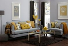 make an accent in a grey room using yellow cushions, lamps and flowers