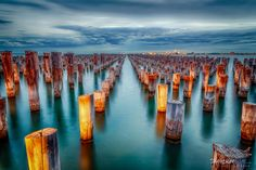 Princes Pier posts at dusk.  The original pier extended out to the end of the posts.  These days, only the posts remain and provide a stunning obligatory photo spot for any photographer in Melbourne.