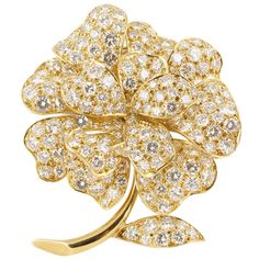 Van Cleef & Arpels Mid-20th Century Diamond Gold Brooch | From a unique collection of vintage brooches at https://www.1stdibs.com/jewelry/brooches/brooches/