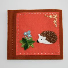 wool felt needle book with happy hedgehog and flowers