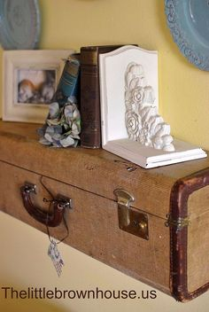 Sharyl's discussion on Hometalk. Suitcase Shelf - I remade an old suitcase into a shelf for my wall. - You can go to my blog to find full tutorial and pictures!