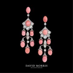 In this picture a three row pink pearl earrings with rose cut pear shapes and round white diamonds, and the perfect romantic set to gift your loved one.